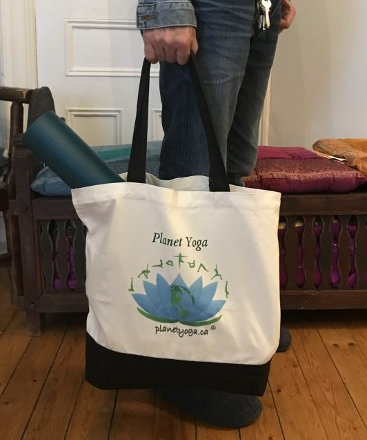 In hand Planet Yoga tote bag